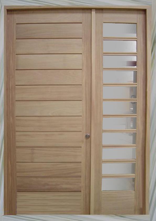 Puertas de entrada hechas en madera carpinteria fusta for Puerta entrada madera